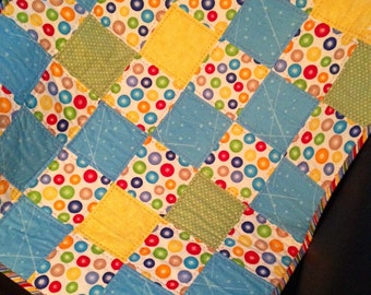 "Primary Colored Polka Dots, Bright Crayon Colored Stripes and More Combine Beautifully In This 27"" X 31"" Carseat/Stroller or Doll Quilt"