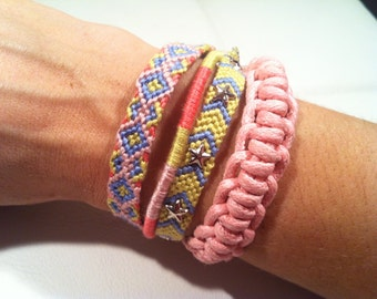 Set of 4 bracelets. Handwoven and braided bracelets in pastel colors with star spikes