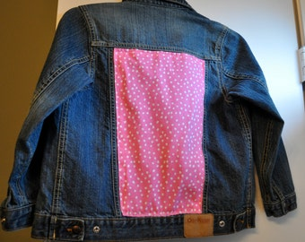 Girls jean jacket with pink polka dot fabric on the back