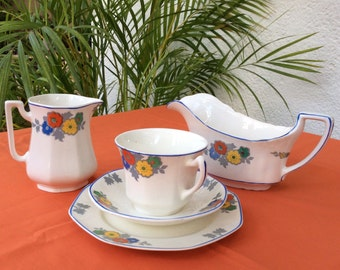 Pretty tea cup, saucer, plate and 2 jugs