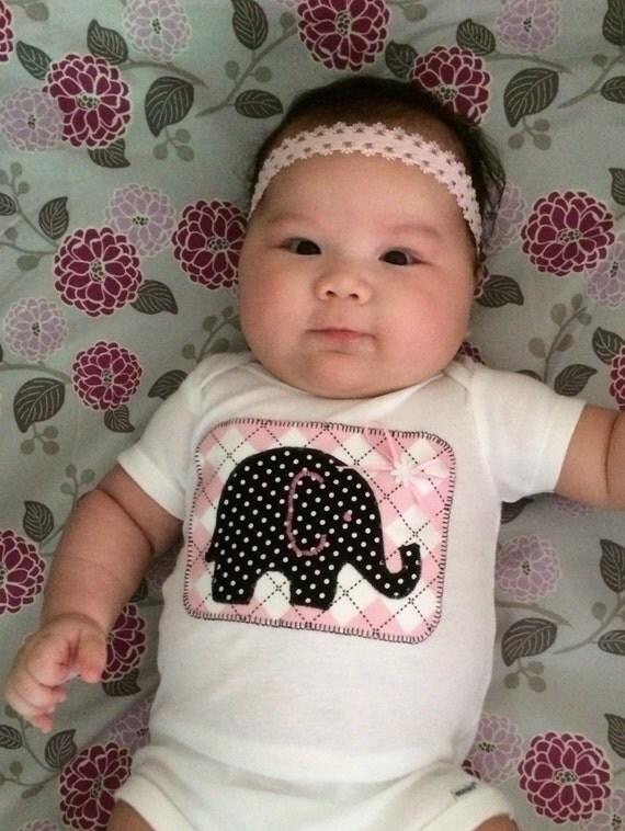 Baby girl's onesie with elephant appliqué