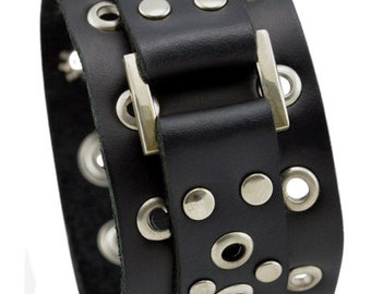 Studded leather cuff bracelet with eyelets, Wide black strap leather bracelet with a large central metal square and eyelets along its length
