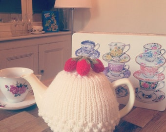 Hand knitted strawberries and cream tea cosy