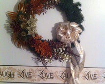 Elegant and classic holiday evergreen wreath with poinsettia.
