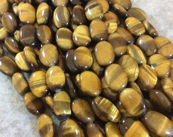 Tiger's Eye Oval Beads, 13mm x 18mm, approx. 22 beads per strand.