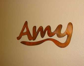 This beautiful metal art piece of the name Amy