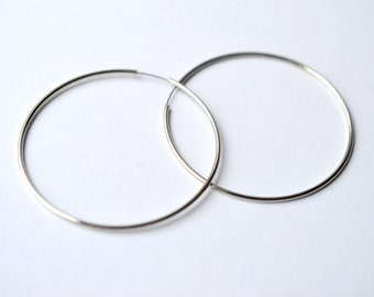 Earring, Phodium, 45mm round hoop with pin closure. Sold per pkg of 5 pairs