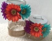 Mason jar and small jar with flowers