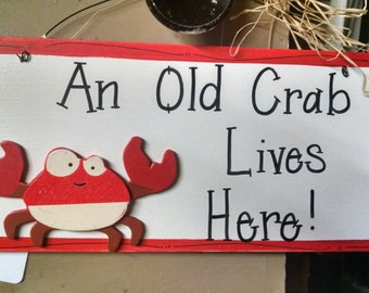 An old crab lives here door sign