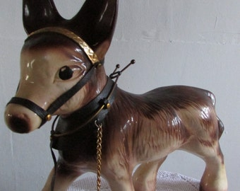 "kitch ceramic donkey 12"" high."