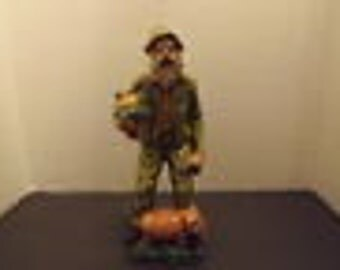 10in.  Man with Pig Figurine - Marked