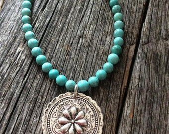 Turquoise beaded necklace with embellished pendant