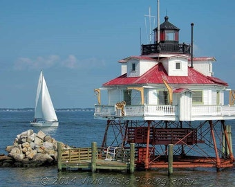 Lighthouse photography - Thomas Point Lighthouse and a nearby Sailboat in the Chesapeake Bay