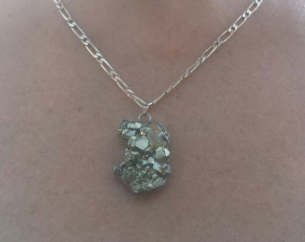 Pyrite pendant set in sterling silver
