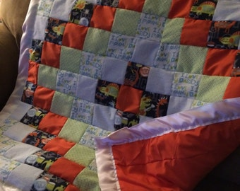ON SALE NOW Rockin' Dinosaur Baby Quilt -- Orange and Greens