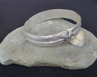 Cuttlefish cast solid silver bangle