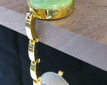 Folding purse hanger. Handmade with green acrylic. Makes a useful and unique gift by Specialty Turned Designs