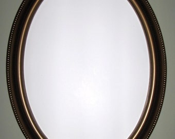 Bronze color frame oval mirror.  bathroom mirror, vanity mirror.