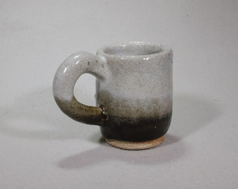 Small white and black stoneware mug.