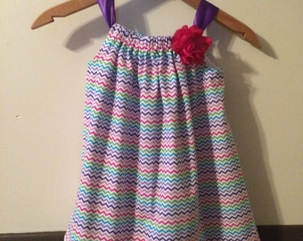 Pillowcase style sundress in a bright chevron fabric.
