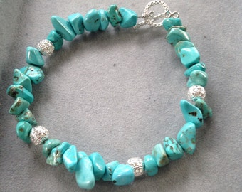 Light Turquoise with silver accents and a silver toggle