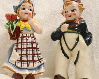"Vntg royal Japan hand painted dutch  boy and girl 9""h girl has tulips in her arm,sweet as they are looking at each other japan quality"