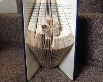 Book folding art pattern curved mum with a flower