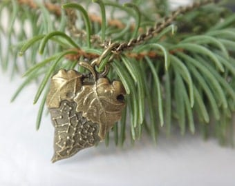 Strawberry on antique brass chain. Pendant Bronze. The choice and choice of chain length.