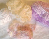 Mixed trim remnants, broderie anglaise, lace, white, cream, purple, pink