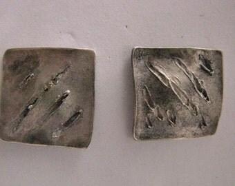 Silver earrings button model.