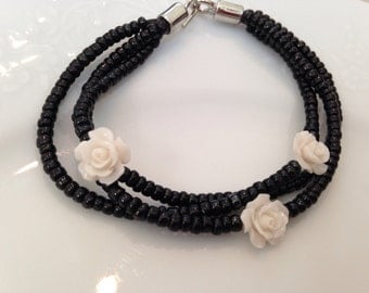 Black and white rose multi strand bracelet made with repurposed beads
