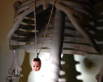 Baby head pendant necklace