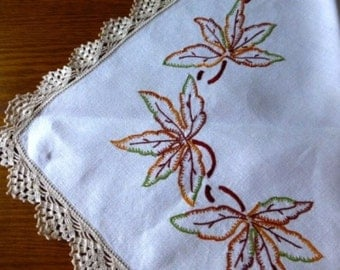 Vintage linen tablecloth hand embroidered with autumn leaves design