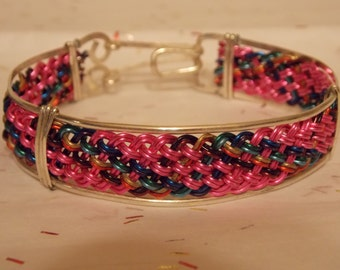 Pink silver plated wire braided bracelet