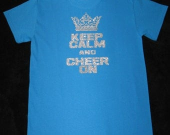 Custom Cheer Shirt in Turquoise and is a Small, Keep Calm and Cheer On is on the Front in Silver Glitter