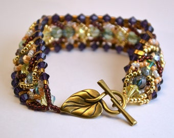 Earthy Green and Purple Crystal Beadwoven Bracelet with Brass Leaf