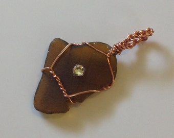 Brown Sea Glass hand wrapped in Copper Wire.