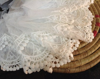 White scalloped lace with baby pom poms.