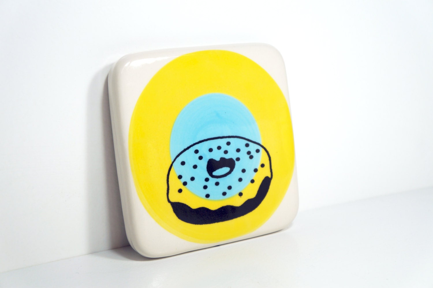 tile with a donut on yellow & sky blue colour block target. Made to Order.