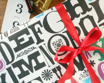 alphabet gift wrap black & natural with pops of color wrapping paper baby birthday all occasion typography