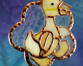 Stained Glass Duckling Suncatcher with snow flake glass background
