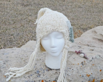 Falconer Pixie Wool Patch Hat - Hand Knit Wool Bonnet With Tassels and Handwoven Patchwork Accents. Cream White, Jade, Sage. Pocket!