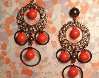 Vintage orange and brass filigree post earrings.