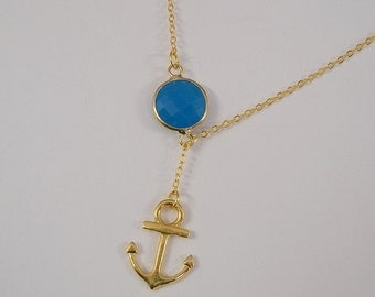 Nautical Gold Necklace with a Anchor  and Blue Stone.