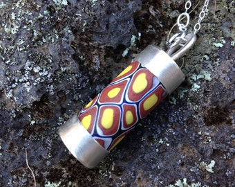 Sterling silver and antique Venetian millefiori African trade bead pendant. Medium red/yellow pattern.