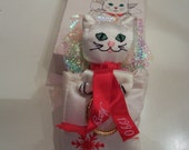 Vintage holiday ornament Rare Fancy Feast Kitty Cat ornament in box  1990 no longer in production White kitty in shopping bag.
