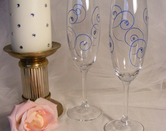 champagne toasting glasses with blue swirls and clear Swarovski crystal rhinestones for wedding anniversary birthday