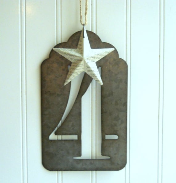 Large metal number four stencil hanging with vintage french dictionary