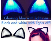 Glowing Blue Clip On Cat Ears, Black And White Costume Cosplay Rave wear Festival Accessory Blacklight LED Light Up EDC Electric Forest