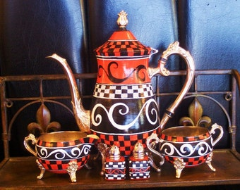 Red, black and white swirls Hand painted painted with siiver yea pot.'